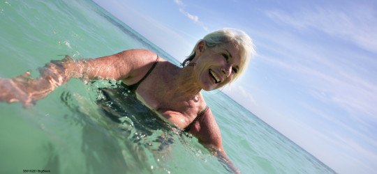 2bigstock-Senior-woman-in-the-sea-35010221